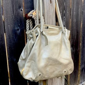 pearlized platinum embossed floral leather purse